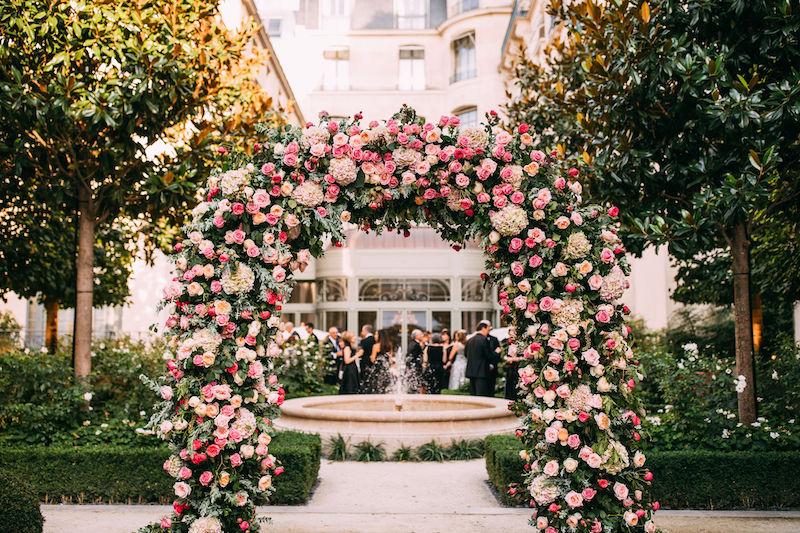 Paris garden wedding ceremony arch with American wedding planner Fête in France