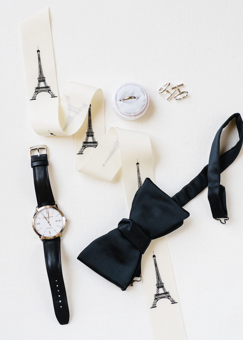 Flatlay of groom accesssories for a Paris wedding